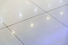 Blurry background of Reflections  white light in a tiled floor for abstract Stock Image