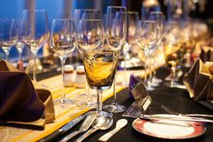 Blurry background set up glass on dinner table. stock photography