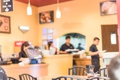 Blurry background waiters serving food at compact Vietnamese noodle restaurant. Blurred image of checkout counter at Vietnamese Noodle Pho restaurant in Humble royalty free stock images