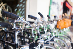 Blurry bikes in row. Background. Blurred background with bikes parked in row Royalty Free Stock Image