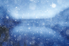 Blurry blue background with snow texture Stock Photo