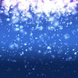 Blurry Blue Christmas Background. Blurry christmas background with bokeh effect Royalty Free Stock Photography