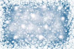 Blurry blue color abstract snowflakes. Christmas background Stock Images