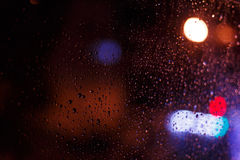 Blurry bokeh and water drop from rain Stock Photos