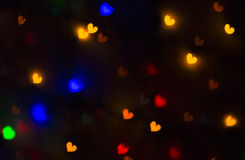 Blurry bright background abstraction with coloured hearts Stock Photos
