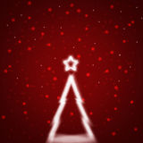Blurry bright Christmas tree with red abstract stars background Stock Photography