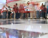 A blurry cafeteria line. An all you can eat pizza/cafeteria joint - the shot is from the checkered floor looking across at the food line and with a time exposure Royalty Free Stock Image