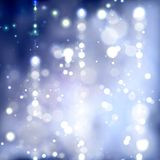 Blurry Blue Christmas Background. Blurry christmas background with bokeh effect Stock Photo
