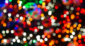 Blurry Christmas lights. On a christmas tree as background royalty free stock image