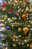 Blurry christmas tree. Blurred background from christmas tree with baubles and the lights Royalty Free Stock Photos
