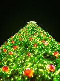 Blurry Christmas tree on black Stock Photo