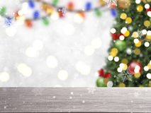 Blurry Christmas tree with decorations and snowflake on bokeh Stock Image