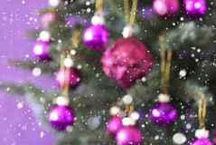 Blurry Christmas Tree With Rose Quartz Balls And Snowflakes Royalty Free Stock Photo