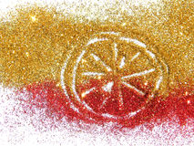 Blurry citrus fruit of golden and red glitter sparkle on white background Stock Photo