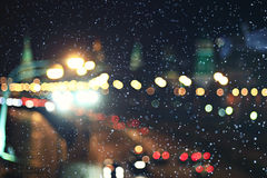 Blurry city lights with snow Stock Image