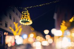 Blurry city lights, streets with Christmas decorations. Night city, blurry bokeh lights, houseswith light in the windows Stock Photo
