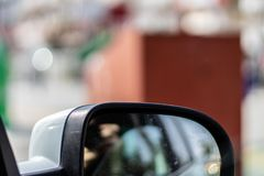 A blurry closeup shoot to car side mirror while moving stock photo