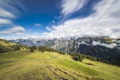Blurry clouds on a sunny day in the mountains Royalty Free Stock Photos