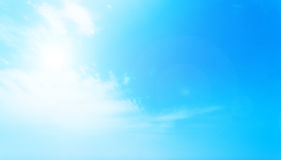 Blurry Cloudy blue sky abstract background with sun beam Stock Image