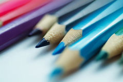 Blurry cold colors pencils with fuzzy edges on white background. Obliquely oriented. Close up view Royalty Free Stock Image
