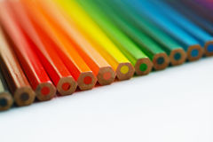 Blurry color pencils with fuzzy edges on white background. Close. Blurry color pencils with fuzzy edges on white background. Macro Royalty Free Stock Photography