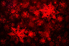 Blurry dark red colored abstract snowflakes background Stock Photos