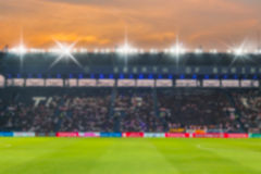 Blurry de-focused stadium football  twilight background. Blurry de-focused stadium football  twilight background Royalty Free Stock Photography