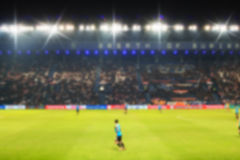 Blurry de-focused stadium football  twilight background. Blurry de-focused stadium football  twilight background Royalty Free Stock Photo