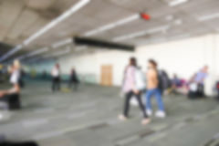 Blurry defocused image of passenger at the airport terminal Stock Photo