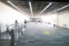 Blurry defocused image of passenger at the airport terminal Stock Photos