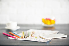 Blurry desktop with various items. Blurry desktop with colorful pencils, sketch, smart phone, coffee cup and other items stock photo