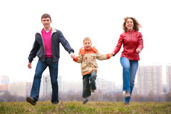 Blurry family jump outdoor in city Royalty Free Stock Image