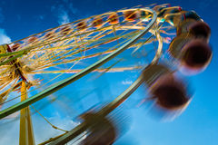 Blurry ferris wheel in motion Stock Photos