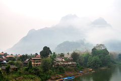 Blurry fog morning with an image of a mountain lake and haze at Stock Photo