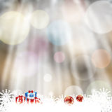 Blurry forest background with white snowflakes Stock Photos