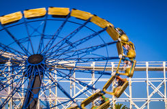 Blurry Giant Wheel moving fast. At an amusement park a Giant Wheel is moving rapidly Stock Photo