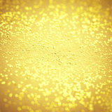 Blurry Gold sparkle texture. Abstract Bokeh Golden glitter backg. Round. Gold metal textured foil effect Stock Image