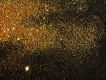 Blurry golden glitter sparkle on black background Royalty Free Stock Photo