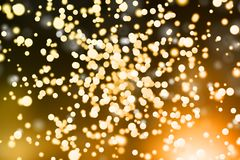 Blurry golden wallpaper. Creative glowing blurry golden bokeh wallpaper. New Year, Christmas and celebration concept vector illustration