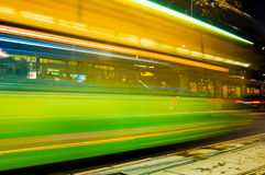Blurry green lights city bus at night Stock Photography
