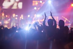 Blurry image background of many audience concert in rock con stock photos