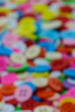 Blurry image of colorful sewing buttons clasper Stock Photo