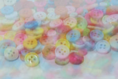 Blurry image of colorful sewing buttons clasper Royalty Free Stock Image