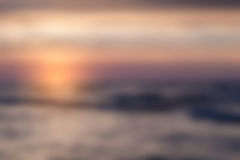 Blurry landscape with sunset on sea Royalty Free Stock Image