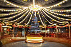 Blurry light background with long exposure of carousel rotating during christmas fair Stock Photography