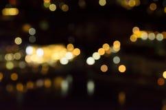 Blurry light night. Dark, yellow, orange, white, black, romantic Stock Photos