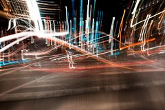 Blurry light tracks at a carnival fair stock images