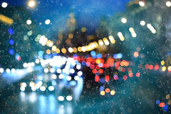 Blurry lights  in snowy evening city Stock Photography