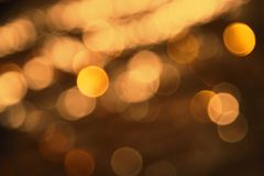 Blurry Bronze Lights Background, Party, Celebration Or Christmas Texture Stock Photo