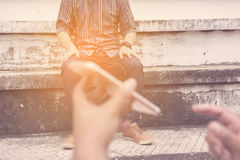 Blurry man sitting on outdoor grandstand. Stock Photography